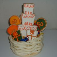 "40Th Cookie Basket NFSC with royal icing. I used the melted chocolate method to put cookies on sticks. I made the basket from chocolate ""clay.""..."