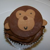 Monkey Cupcake These were for my neice's birthday...she loves monkeys. Chocolate fudge, with chocolate buttercream. Monkey is made out of fondant.