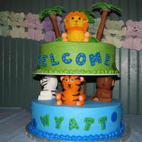 Jungle Animal Shower Cake  This is my version of the Wilton Safari Cake for my cousin's baby shower. Buttercream with fondant animals and accents. Trees are...
