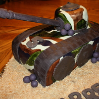 Garret's Army Tank Cake This was my son's Army Tank birthday cake to go with his camo theme birthday party. It was actually really fun to make. Covered in MMF...
