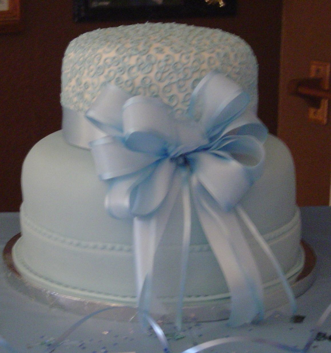 Black Tie Affair/2006 Wilton Yearbook I did this Wilton cake designg in baby blue for my friends baby shower. My friend knew she was having a boy. He was born on Feb 9, 2006....