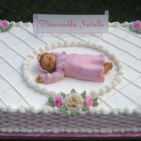 Sleepy-Baby   whip cream frosting. Flowers and baby are gumpaste, edible sign