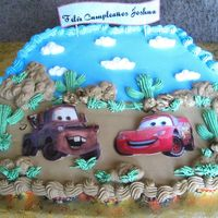 Cars  I got the idea for this cake from boween's. This was a little cupcake -cake for my youngest baby's birthday. Edible images....