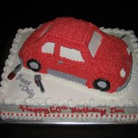 Vw Bug Cake i made this cake for a woman whose husband used to own a VW bug repair shop. the tools are candles since i didn't have time to make...