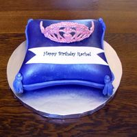 My Daughters Tiara  Pillow is covered in fondant and airbrushed purple. The crown is chocolate, because my royal icing crown broke at the last minute. The...
