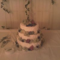 "Wedding Cake Decorated With Fruit Stacked wedding cake with fresh fruit instead of flowers. Also client wanted a ""stucco"" effect for the icing.Sorry photo is bad..."
