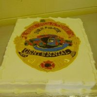 Fire Dept. Centennial Badge This is the centennial badge. It's on a full sheet cake (18x24) I also freehanded this one with gold and various other color icings...
