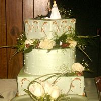 "Green Brown And Ivory Wedding Cake This is a 14"" square and 12"" round and 8"" square cake with the top layer elevated on tiers and pillars. Is all Buttercream..."