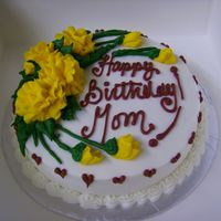 Marigold Birthday Cake   This is a simple little single layer cake for a birthday. The only two requests were that it have some flowers and be gold and maroon.