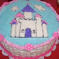 Whimsical Princess Castle made for my niece's 6th bday. Wilton BC, and 4 layer choc /yellow cake. star tech to make the picture, basketweave side, royal icing...