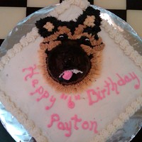German Shepherd Birthday cake for a little girl who wanted the likeness of her dog's head on the cake