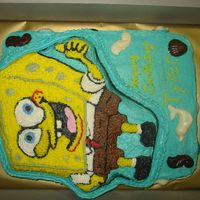 Sponge Bob Yellow and white half sheet cake with a chocolate spongebob stacked on top. All covered in buttercreme icing with molded chocolate shells,...