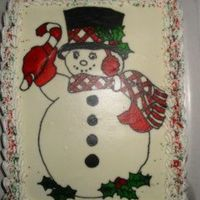 Snowman.jpg First time I used a projector to draw a design. I drawed it on an icing sheet then put it on the cake.