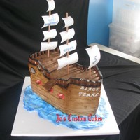 "Pirate Ship Covered in fondant ""planks"". Mast and cannon port holes are poster paper. Posts for railing are tootsie roll pops. I need to..."