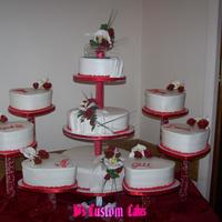 Rose And Orchid Wedding This was for an older couple getting married. The cakes are all buttercream with gumpaste roses and moth orchids. The 6 satelitte cakes had...