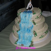 Waterfall Wedding The bride wanted a waterfall wedding cake because he hubby to be loved fishing. She had the bride dragging the groom cake topper and there...