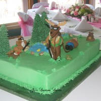 Deer Hunting Hunter This is a grooms cake for an avid hunter. The bride wanted something funny for the groom, hence the deer bagging the hunter. It was a fun...