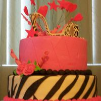 Zebra Cake   Chocolate with strawberry filling. Buttercrean and fondant decorations, I would like to thank all CC members for their inspiration .