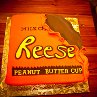 Reeces Cup  Butter cake with Reeces Cup SMBC. Covered in fondant with GP and RI accents. This is the only picture that I have, but there is a bite out...
