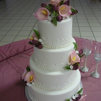 Litonya Almond Pound Cake with buttercream filling and Fondx. Royal piping with pearls and silver dragees. GP flowers.