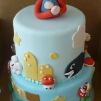 Super Mario Super Mario Cake. Almond Pound Cake, Fondant covered w/ GP accents