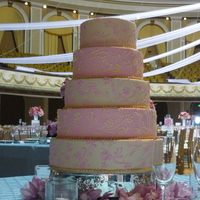 Patel Wedding Ivory and Pink alternating tiers. Chocolate with raspberry preserves, vanilla bean pound cake and chocolate ganache on one tier, remaining...