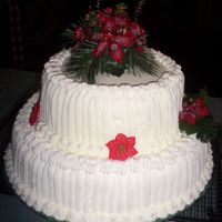 Poinsetta Wedding Cake I am definately not a pro but it was fun to make. I made this for my father-in-law's wedding. It was very informal and just a few days...