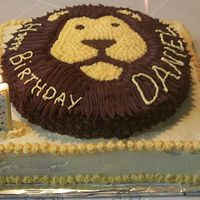 Lion Cake   My very first birthday cake. It was a 10 in round on top of a 12 in square. We had cake for a long time!! :-)