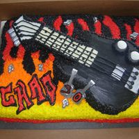 Guitar Birthday Cake For a friend's 30th bday. he has a black bass with a maple neck. i had SO much fun making this cake. i used a flame fade technique...