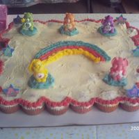 Care Bear Cupcake Cake  This was my 1st cupcake cake. It was 50 cupcakes for my niece's 4th B-day. She loved it. I made it along with the elephant cake since...
