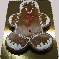 Gingerbread All Around Gingerbread Man carved out of 1/2 sheet cake and decorated in chocolate BC