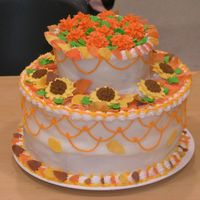 Autumn Cake I did this cake a few months ago at Michael's for a class demonstration. The leaves are gumpaste, the flowers are royal icing and the...