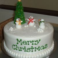 "Snowmen 3-layer 10"" yellow cake, iced in BC....sugar cone tree with BC, dragees & MMF lights....MMF snowmen & balls"