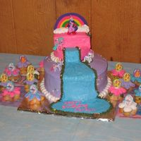 My Little Pony Cake The bottom layer is chocolate, the top layer is butter cake. The cupcakes are white cake with sprinkles. I used all buttercream to frost...