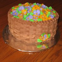 Basket Full Of Pansies?  This is an oval cake made for a friend's b-day. It is a yellow cake with chocolate buttercream icing. It is decorated with basket-...