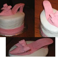 "Shoe Cake For Sara  This cake is for a friend's birthday. She is shoe crazy. It's an oval cake with buttercream icing. The shoe and ""ribbon&quot..."