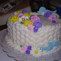 Course 2 Cake Buttercream.. dont remember whats in it (was a long time ago). Royal icing flowers.