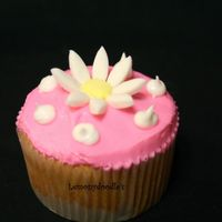Daisy Cupcake   butter yellow cupcake w/ buttercream frosting in Pink. Satin Ice Daisy on top. Inspired by katharry. Thanks