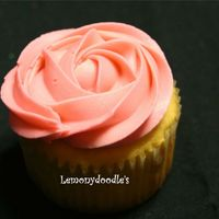 Our Signature Cupcake - The Rose Swirl butter yellow cupcake w/ buttercream frosting in petal pink. This is my most requested cupcake. I use a tip 1M to make this particular...
