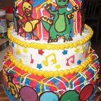 Baby Einstein Cake, Front   A three-tiered cake with a Baby Einstein theme.