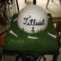 Golf Ball In Green All fondant golfball with sugar tees and royal icing grass. I made a separate flag but it does not appear on this picture. That was made...