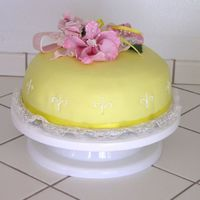 Yellow Cake With Gumpaste Flowers Just a white cake covered in yellow marshmallow fondant. The flowers were my first try at gumpaste and they were a disaster. I tried to...