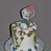 52 Anniversary Cake This is not traditional for an anniversary cake - but my mom loves birdhouses and flowers - so I went with that. All the decorations,...