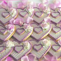 Valentine's Cookies Glace icing and buttercream roses that were brushed with petal dust when dry for some color.