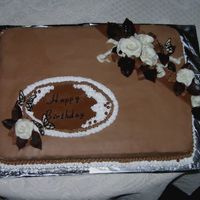 Cake For Mother This is a chocolate sheet cake with chocolate buttercream icing. The roses are molded from candy clay.