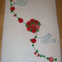 "Roses & Doves  All done in B/C. Cake is two 12x18's put together to form an 18x24"" cake. There isn't a dent in the upper left portion. The..."