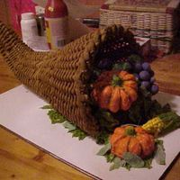 Horn Of Plenty chocolate cake with buttercream frosting, royal icing basket, ding-dong with buttercream pumpkins, chocolate cake with buttercream corn,...