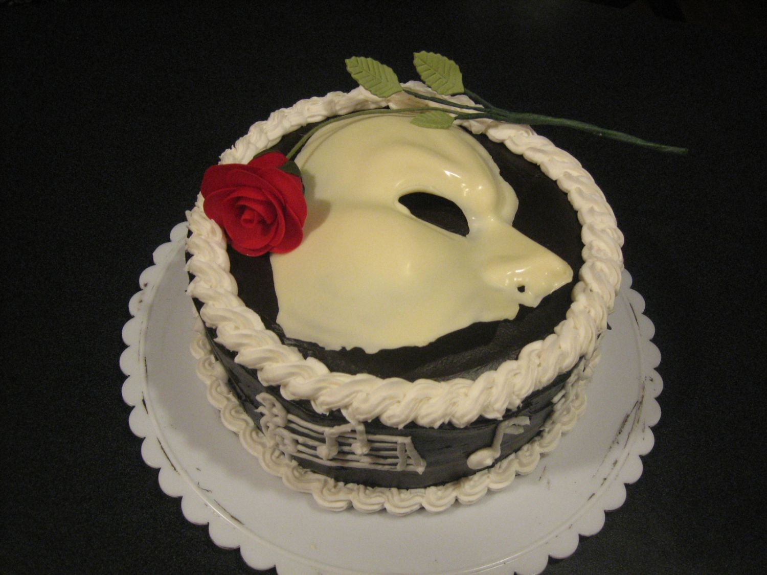 Phantom Of The Opera  Here's the cake that started out as a disaster, but thankfully ended up decent. It's for my daughter's 6th birthday. She&#...