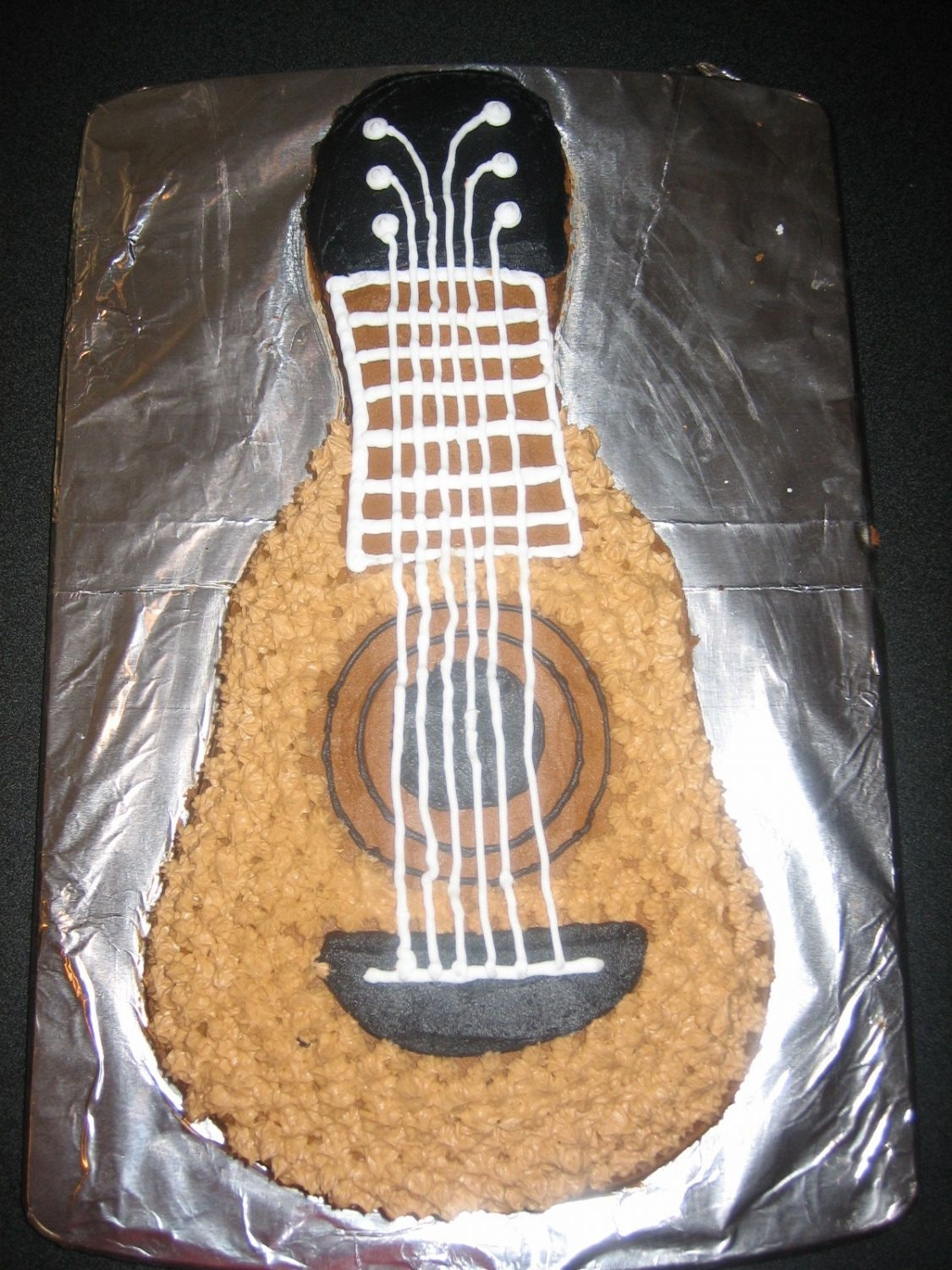 Guitar Cake   Second cake I ever made outside of the Wilton classes. Made it for a guitar playing friend of mine.