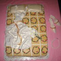 Kelley's Cake  This is a bridal shower I made for my cousin and his fiance. I was inspired by the many cakes in the bridal section and decided to give the...